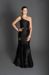 Black gown, one-shoulder neckline, reversible sequin accents, floor-length sequined trumpet skirt.