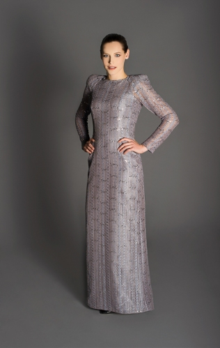 Grey lace gown, full-length sleeves, high neckline, raised shoulder pads, floor-length skirt.