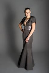 Hexagonal polka-dot gown, deep V neckline, short sleeves, silver sequined midriff, raised shoulder pads, floor-length trumpet skirt.