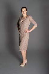 Light brown lace cocktail dress, low V neckline, 1/2-length sleeves, raised shoulder pads, below-the-knee scalloped skirt.