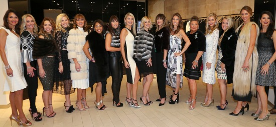 Boston Red Sox wives and girlfriends take part in the 12th annual charity fashion show From Fenway to the Runway presented by Neuro Brands, benefitting the Red Sox Foundation at Saks Fifth Avenue in Boston on Monday, Sept. 21, 2015. From left: event emcee